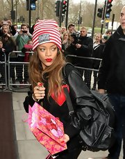 Rihanna's black and white striped beanie was cool and casual for her flight to London.