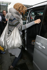 This python print hobo is sure to fit all of the singer's travel needs in it. This seems to be Rihanna's it bag at the money as she has been seen sporting the bag often while traveling.
