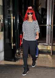 Rihanna showed off a shearling high-top tennis shoe with silk grosgrain ribbon trim, and laces.