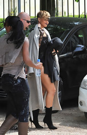 The singer showed off her super toned legs in a pair of blackstiletto boots with white button embellishments.