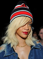 Rihanna wore this striped pom pom beanie with her denim jacket while out and about.
