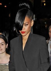 Rihanna arrived at a screening of 'Battleship' wearing her jet tresses in a voluminous bun with ultra-long bangs.