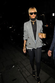Rihanna added shine to her ensemble with gold strappy sandals.