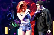 Rihanna looked retro sexy in a pair of torn high-waisted jean shorts on stage in Montreal.