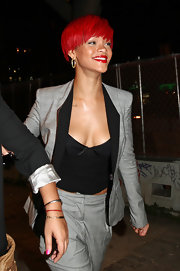 Rihanna showed off her newest hairstyle while out and about in Soho. She paired her locks with blazing red lipstick.