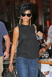 "For a dressed-down outing in New York, Rihanna chose these ""Piolet"" aviator sunglasses."