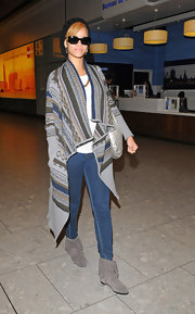 Rihanna looked comfy-chic in an oversize sweater, skinny jeans and suede fringed Ursula booties.
