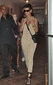 Rihanna certainly knows how to accessorize. She's strapped a sweet shoulder bag over her playsuit for a day out.