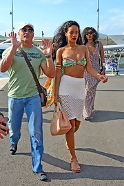 Rihanna shows off her wild side in a vibrantly printed teeny bandeau bikini.
