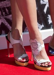 Rita Ora chose a pair of platform sandals with a cool rosebud sketch strap for her look at the launch of her new collection.