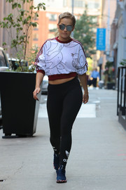 Rita Ora teamed her top with black leggings by Adidas.