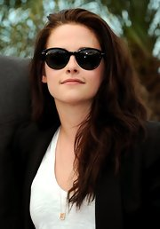 The silhouette of these just-slightly cat-eye frames made Kristen look all the more glamorous during a photocall for 'On The Road.'