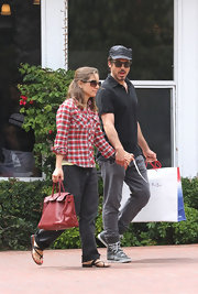 Susan Downey was comfortably dressed in a plaid button-down, jeans, and thong sandals while out shopping with her hubby.