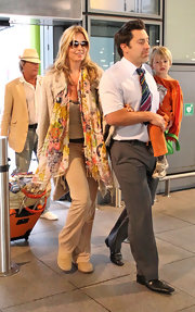 Penny Lancaster added a splash of color to her plain outfit by wearing a floral scarf.