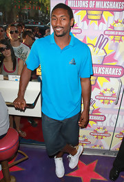 Metta World Peace was the picture of coolness in an aqua polo shirt and denim shorts.