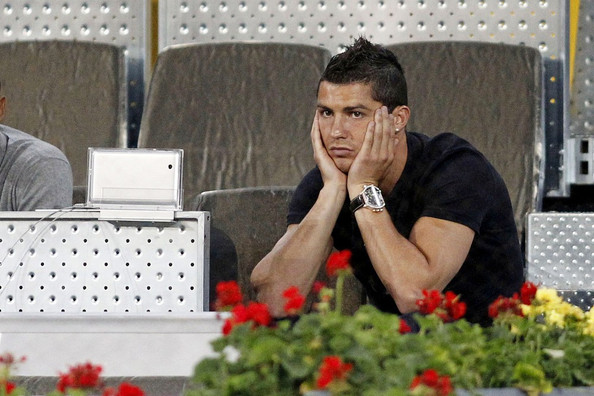 Cristiano accessorized his black shirt with a black leather-banded chronograph watch.