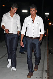 Cristiano Ronaldo looked polished off the field in a crisp white button-up.