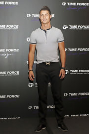 Cristiano was stylist at the Time Force event in a blue and white striped fitted shirt.