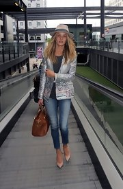 Rosie Huntington-Whiteley looked simply stunning in this silver abstract-printed jacket, which she wore while traveling.