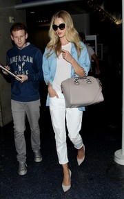 Rosie Huntington-Whiteley cut her all-white palette with a stylish blue denim top.