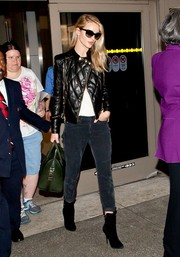 Rosie Huntington-Whiteley looked fiercely chic all the way down to her black suede boots.