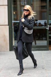 Rosie Huntington-Whiteley bundled up in a black Wardrobe NYC blazer and a Balenciaga sweater for a day out in New York City.