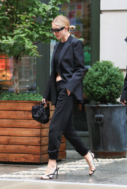 Rosie Huntington-Whiteley was sporty-chic on the streets of New York City in a black Wardrobe.NYC pantsuit teamed with a crop-top.