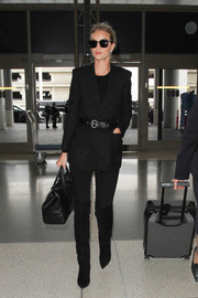 Rosie Huntington-Whiteley polished off her ensemble with black over-the-knee boots, also by Saint Laurent.