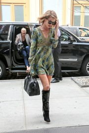 Rosie Huntington-Whiteley added an extra dose of fierceness with a pair of Isabel Marant knee-high boots.