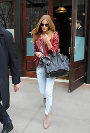 Rosie Huntington-Whiteley lightened her leather look with pale blue skinny jeans, toughened by zippered ankles.
