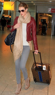 Rosie Huntington-Whiteley arrived on a flight in London lugging a Louis Vuitton rollerboard.