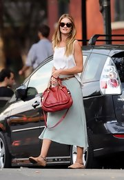Rosie Huntington-Whiteley added a pop of color to her effortlessly stylish street wear with a red leather Paraty bag.
