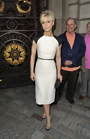 Emilia Fox chose a crisp white frock with black sleeves and a belted black waist for her super sleek look at the Royal Academy Summer Exhibit.
