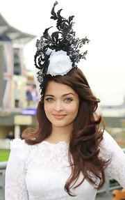 Aishwarya Rai had us looking to the clouds with this sky-high rosebud and lace topper.