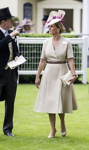 Sophie Countess of Wessex wore this tan A-line dress with a dark brown belt.