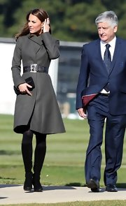 Kate Middleton's mid-calf black boots were a polished finish to her dark green belted jacket.