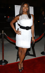 Gabrielle Union paired a demure white dress with black ankle strap heels.