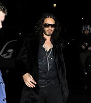 Russell Brand showed off his glam rock style with this black fur coat, which he sported while out partying.