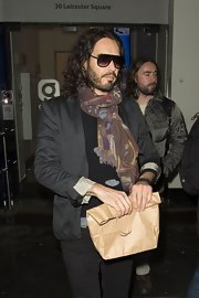 Russell Brand has come to adopt a scarf, like this brown patterned one, as his signature piece.