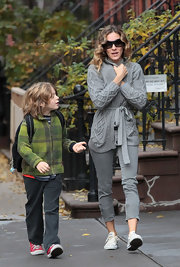 SJP was out and about NYC with son James Wilkie in a gray wrap sweater paired with cream canvas shoes.