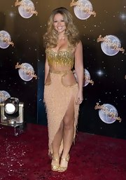Kimberley Walsh completed her sparkly ensemble with a pair of gold evening sandals.