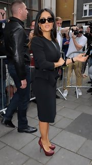 Salma Hayek looked fierce in her black layered dress out in London.