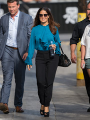 Salma Hayek headed to 'Jimmy Kimmel Live' wearing a long-sleeve blue ruffle blouse by Gucci (but of course).
