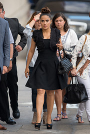 Salma Hayek dolled up her LBD with ruched shrug sweater.