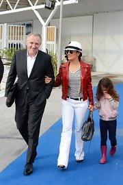 Salma Hayek looked classic and chic in a red leather jacket, which she paired over a blue-and-white striped blouse.