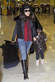 Salma Hayek strolled through the airport in chocolate leather knee high boots.