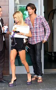 Shauna Sand amped up the edge factor in a pair of studded black platform sandals while out and about in South Beach.