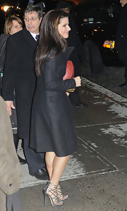 "The gorgeous Ms. Bullock is sporting the twisty ""Verity multi strap"" sandals with her classic black trench coat."