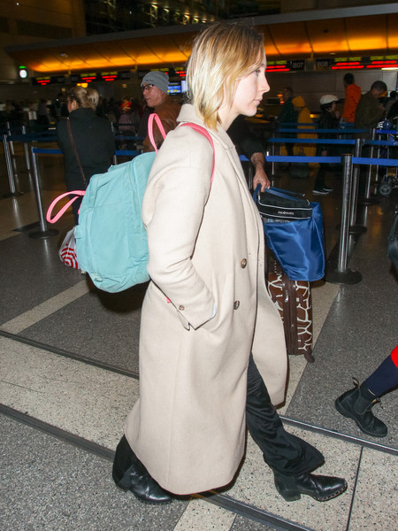 Saoirse Ronan looked like a schoolgirl with her pastel-hued backpack while catching a flight.