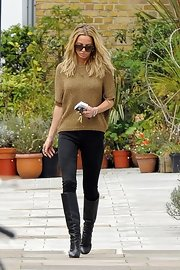 Sarah Harding kept her look sleek and chic with these knee-high black boots.
